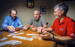 Subject (Left) Don Arnold '76, (Center) Craig Skweres '77 and (Right) Pat Bauer '76, play cards every Thursday night.