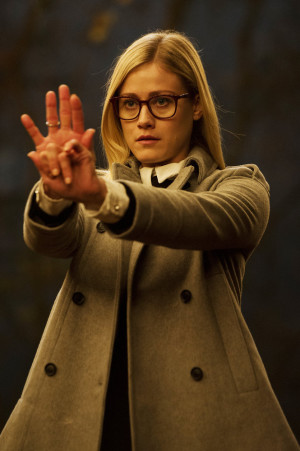 Alice (Olivia Taylor Dudley) practices her version of wand-waving.